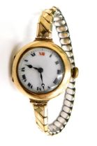 A late 19thC 9ct gold cased wristwatch, the white enamel dial with Roman numerals, in a 9ct gold cas
