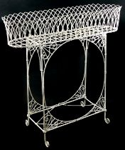 A 19thC wire work jardiniere or plant stand, decorated with arches on end supports with brackets and