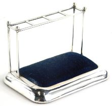 An Edwardian silver novelty hat pin stand, modelled in the form of an umbrella stand, with blue velv