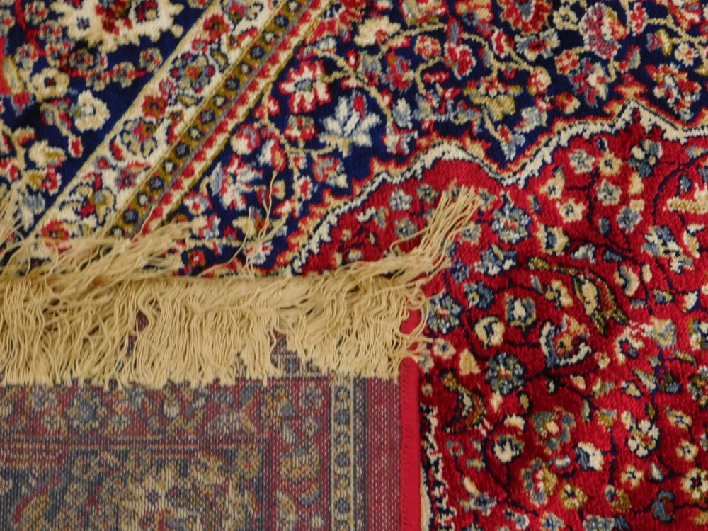 A red ground Kashmere type rug, with a design of a cream medallion, on a red ground with blue spandr - Image 3 of 3