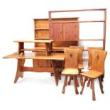 A late 20thC bespoke Parana pine dining room suite, in the Arts and Crafts style, comprising refecto