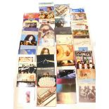 A quantity of LP records, to include Yes, Frankie Goes to Hollywood, Slade, Boomtown Rats, Eagles, P