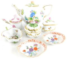 A Herend porcelain bullet shaped teapot, decorated with flowers picked out within gilt borders, etc.