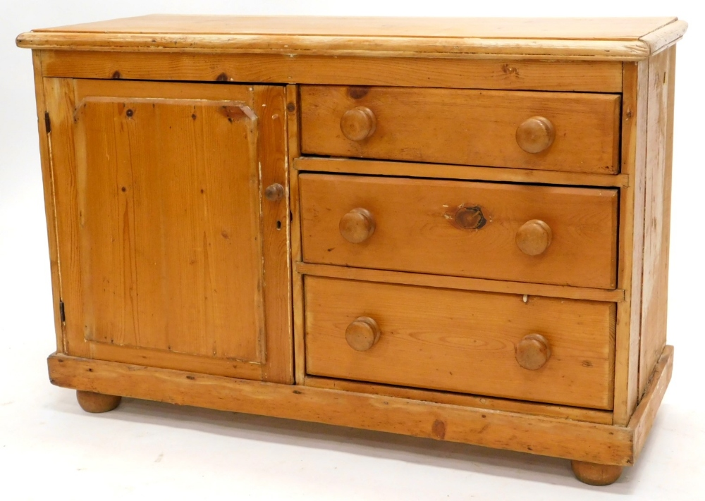 A late 19th/early 20thC stripped pine Lincolnshire type dresser, the planked top with a moulded edge