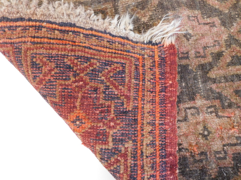 A small Turkish or Afghan mat, with a design of nine medallions, in red, on a brown ground, (AF), 55 - Image 3 of 3