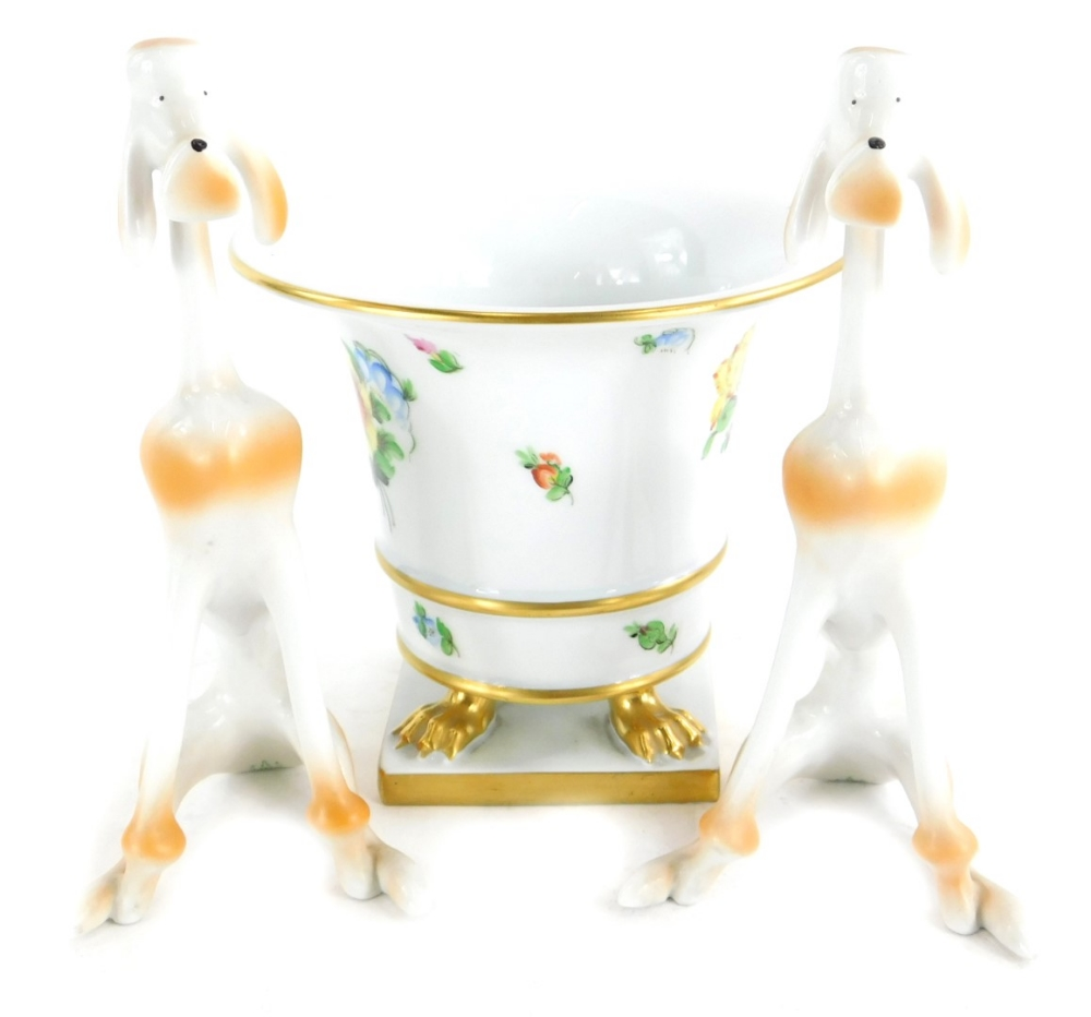 A Herend porcelain vase, decorated with flowers, on three paw feet with square base, 13cm high, and