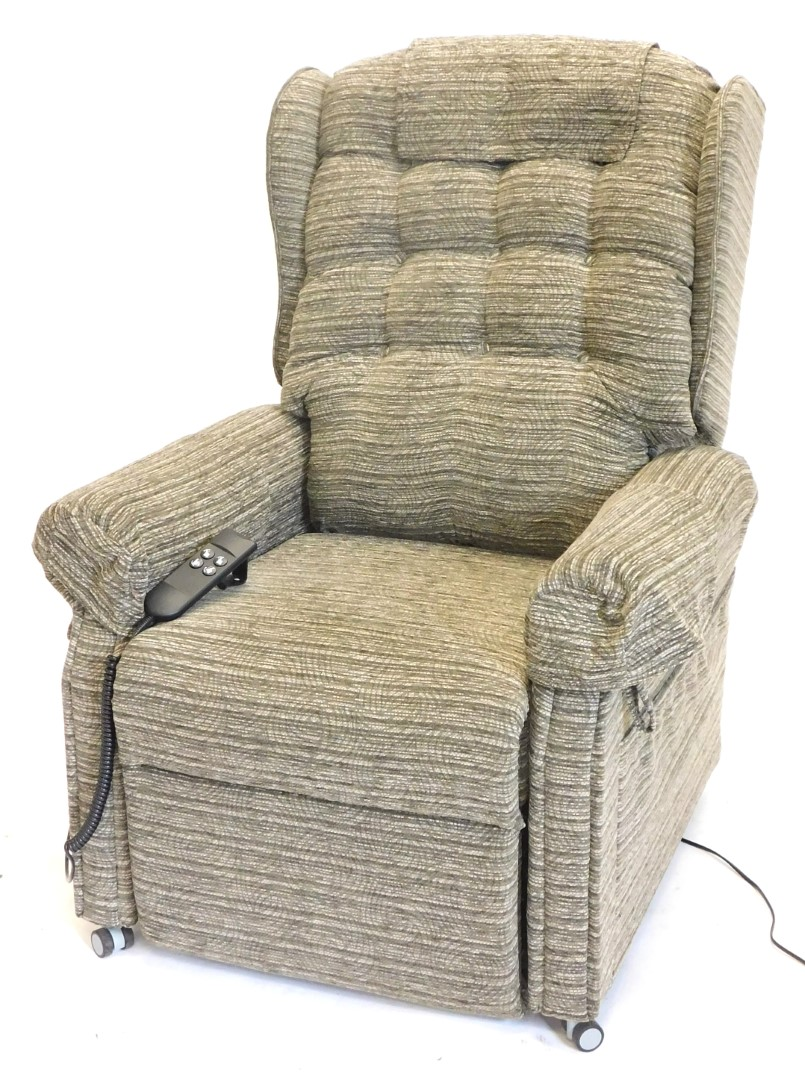 An electric rise and fall armchair, upholstered in patterned grey fabric.