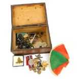 A quantity of military related items, to include World War Two medal, badges, a cap, a small orange