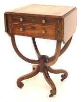 A Regency rosewood work table, the rectangular crossbanded top drop leaf top with canted corners abo