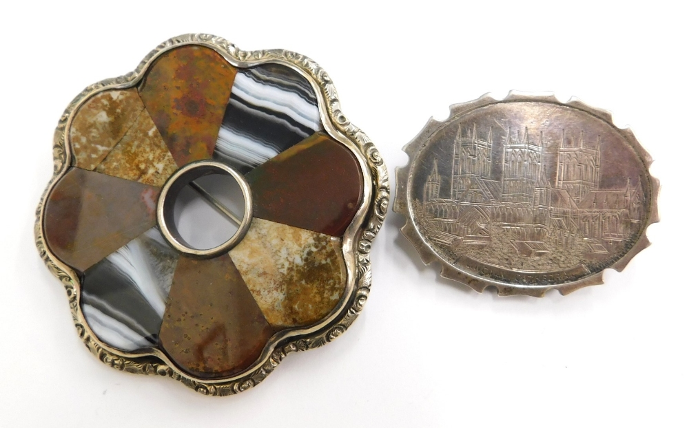 Two silver brooches, to include an oval silver brooch depicting Lincoln Cathedral, 4cm wide, togethe