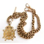A 9ct gold watch chain, the curb link watch chain with two clip ends, t-bar and additional chain dro
