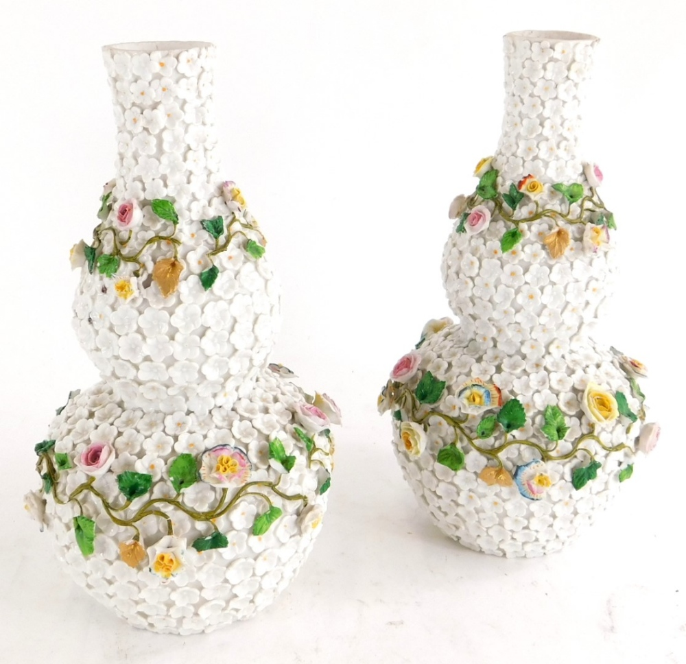 A pair of continental porcelain double gourd shaped vases, each with flower encrusted decoration, bl