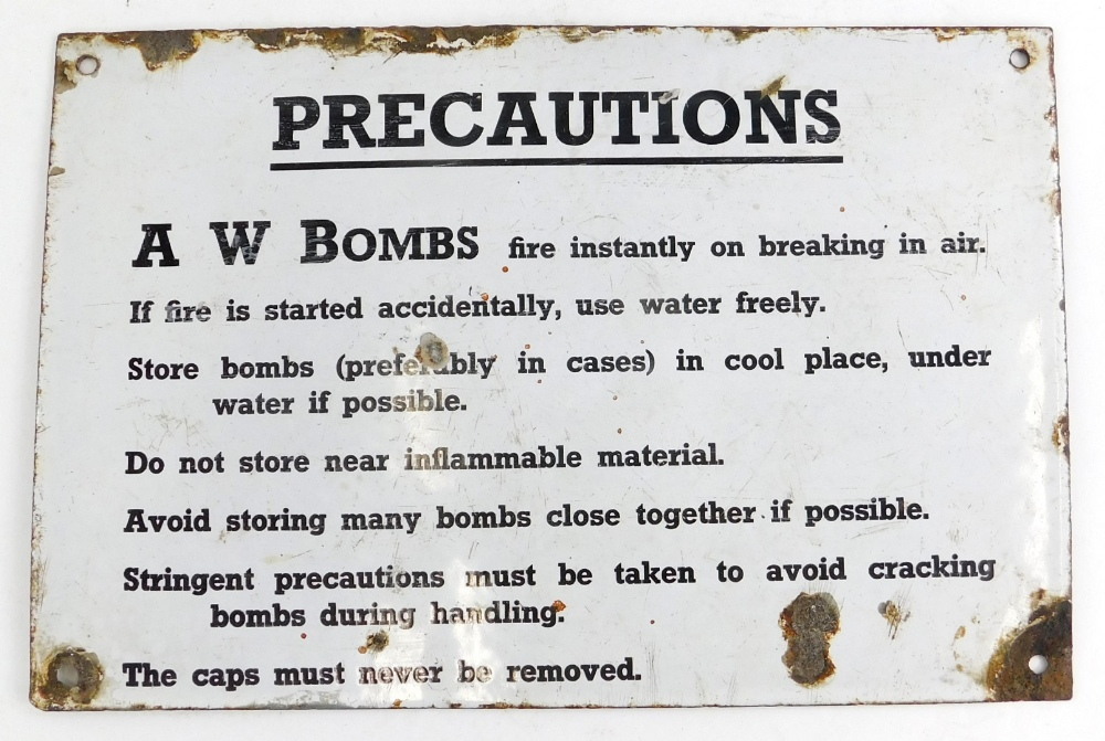 An original Second World War enamel sign, for A W Bombs, detailing precautions, (AF), 20cm x 30cm.