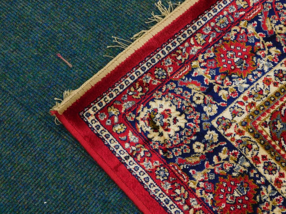 A red ground Kashmere type rug, with a design of a cream medallion, on a red ground with blue spandr - Image 2 of 3