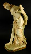 A Royal Worcester porcelain figure of Bather Surprised, modelled beside a tree stump on a canted rec