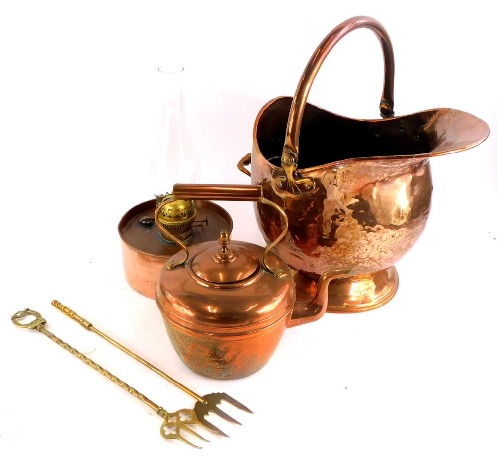 A copper coal scuttle, with swing handle, a paraffin lamp, copper kettle, etc.