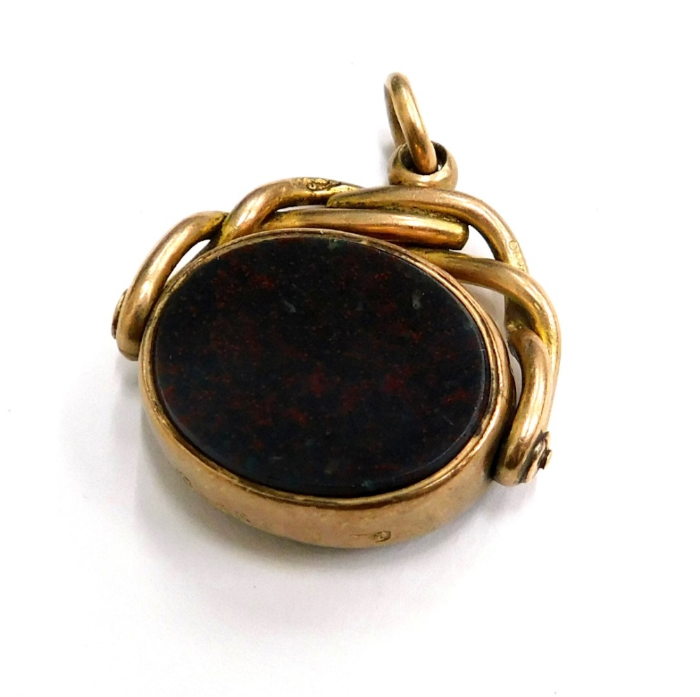 A 9ct gold swivel agate fob, set with red and green bloodstones, with a twist design top frame and s