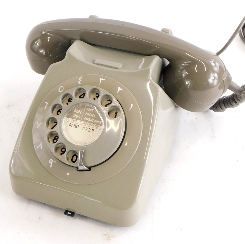 A 1984 vintage GPO/BT two tone dolphin grey telephone, with Arabic dial surround.