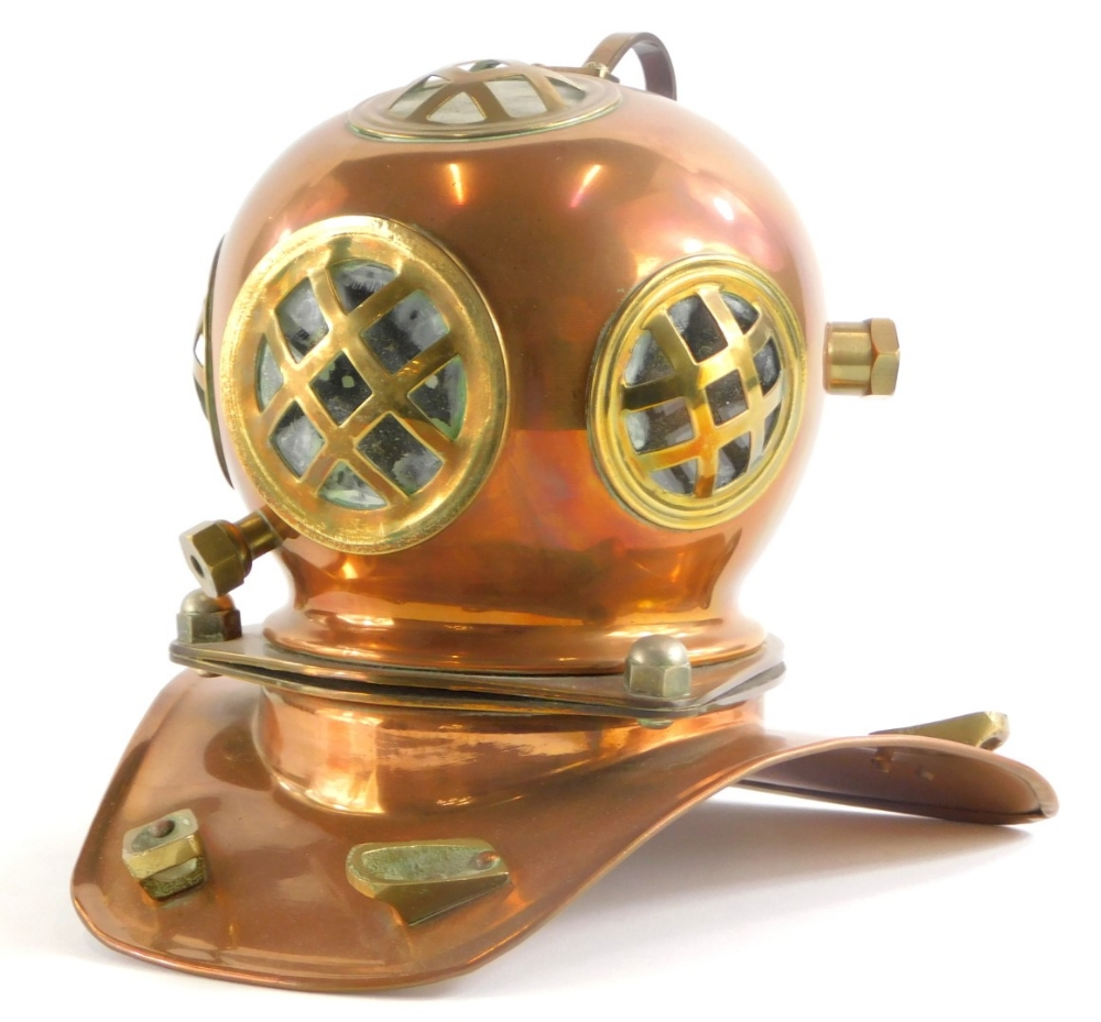 A copper and brass model of a diver's helmet, 18cm high.