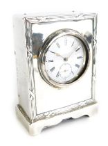 An Edward VII silver cased desk clock, by Henry Matthews, with an enamel Roman numeric dial, Birming