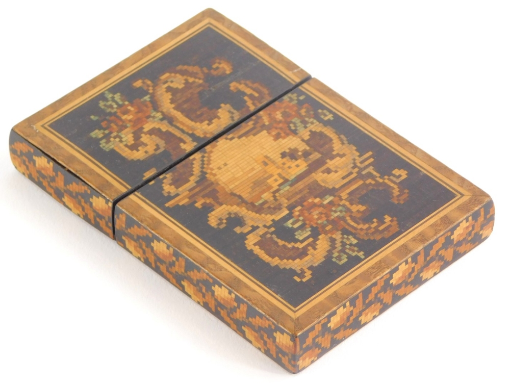 A 19thC Tunbridge ware card case, inlaid with a cartouche to one side and a cube design to the rever