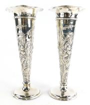 A pair of early 20thC silver vases, by William Comyns and Sons, of tapering trumpet form with a flut