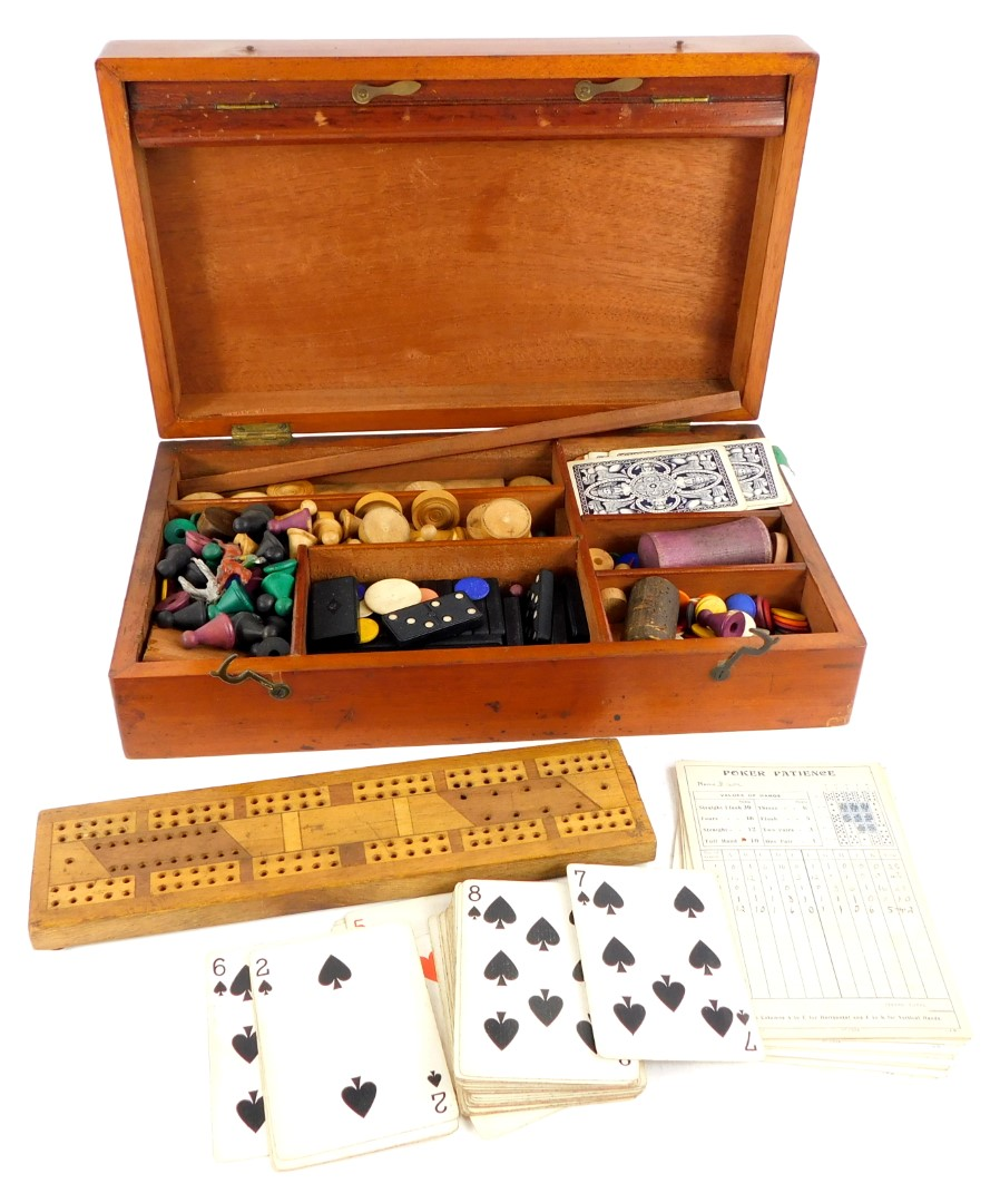 A late 19th/ early 20thC mahogany games box or compendium, to include draughts, cribbage, dominoes,