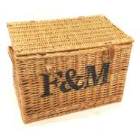 A Fortnum and Mason wicker hamper, with leather straps, 55cm wide.