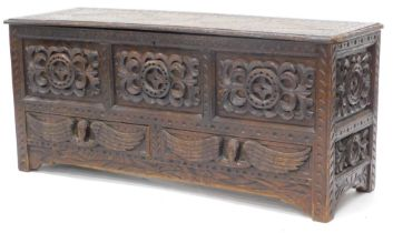 A late 19thC stained oak mule chest, the hinged top carved with lozenges and with a moulded border,