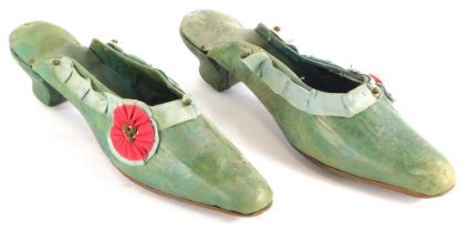 A pair of 19thC ladies green leather shoes, embellished with fabric rosette and cut steel, 25cm long