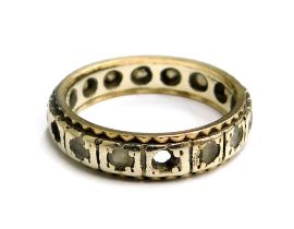 An eternity ring, set with white paste stones in a white metal setting, unmarked, ring size M½, 3.6g