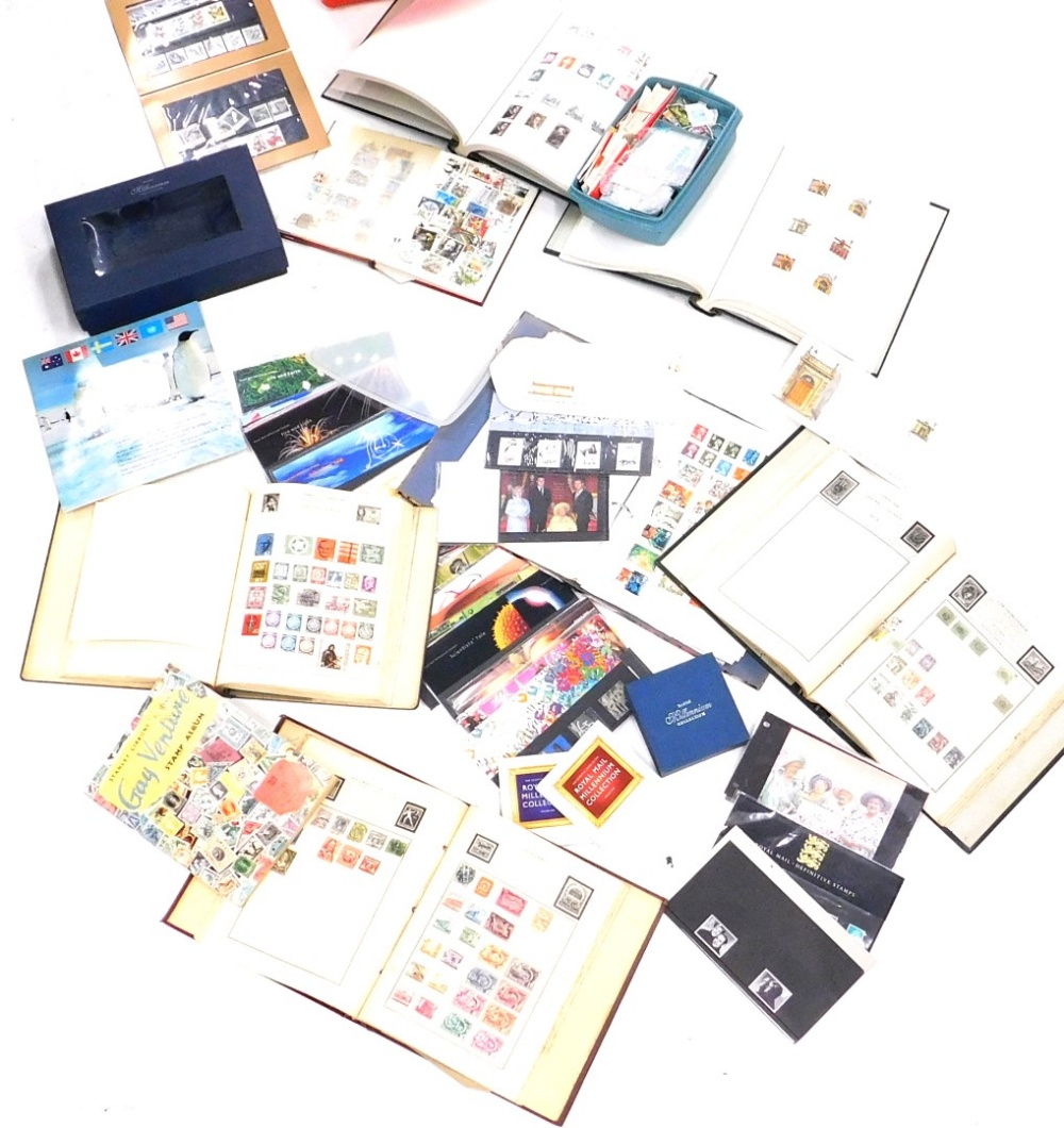A quantity of stamps, to include albums, First Day covers, the Royal Mail Millennium collection, etc