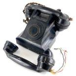 An incomplete vintage black Bakelite telephone, stamped to underside 4509B, (AF), and an extra black