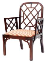 A George III mahogany Cockpen chair, with a shaped back and arms each with a lattice insert, with a