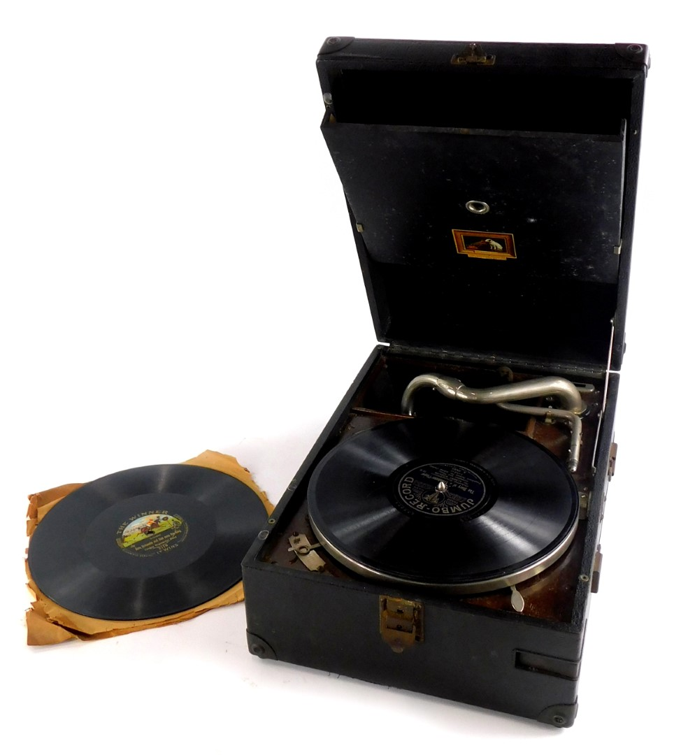A HMV black canvas cased portable gramophone, with single 78 record.