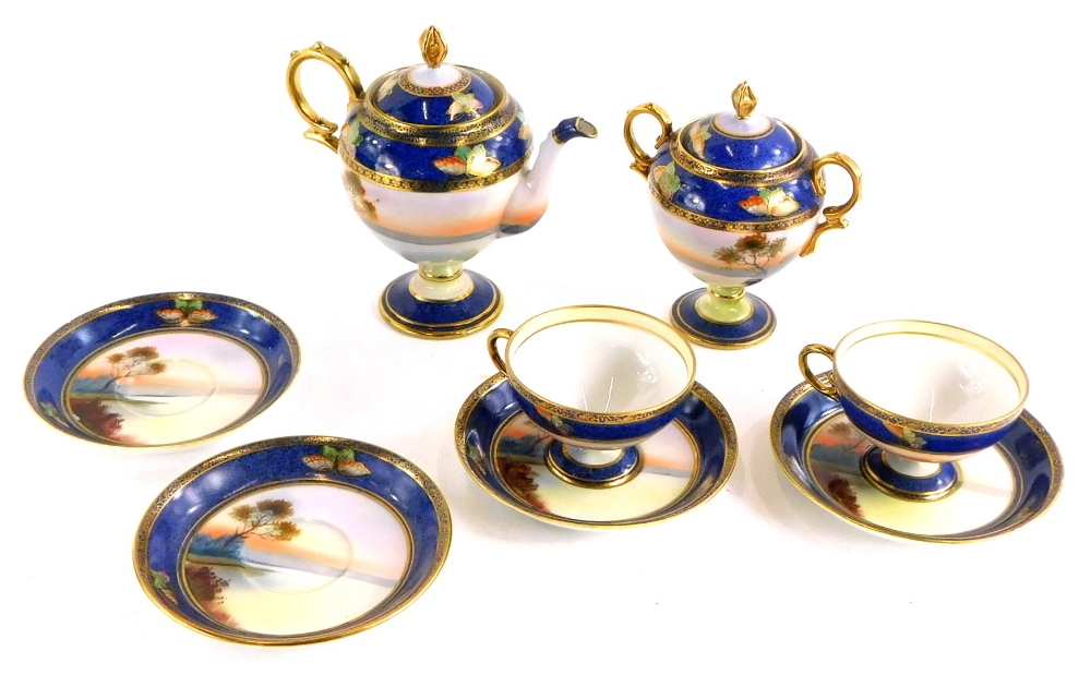 A Japanese Noritake porcelain part coffee service, painted with European rural landscapes, with swan