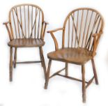 Two similar 19thC ash and elm Windsor chairs, each with a shaped back, spindle turned supports, a so