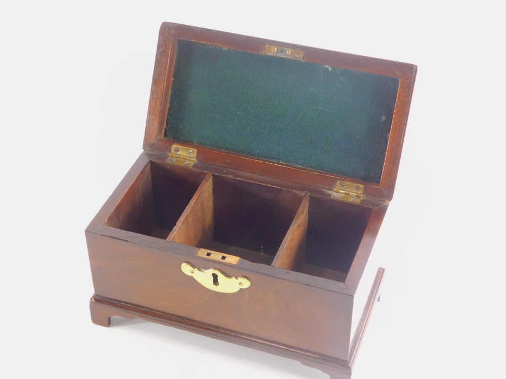 A George III mahogany tea caddy, the hinged lid with a brass handle, enclosing three vacant division - Image 2 of 2