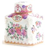 A continental porcelain tea caddy and lid, decorated in famille rose palette with flowers, leaves, e