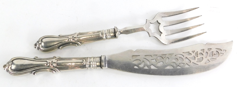 A Victorian silver handled fish servers, the handles cast with scrolls etc., possibly by Joseph Roge
