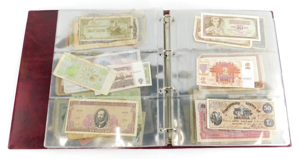 Approximately one hundred world banknotes.