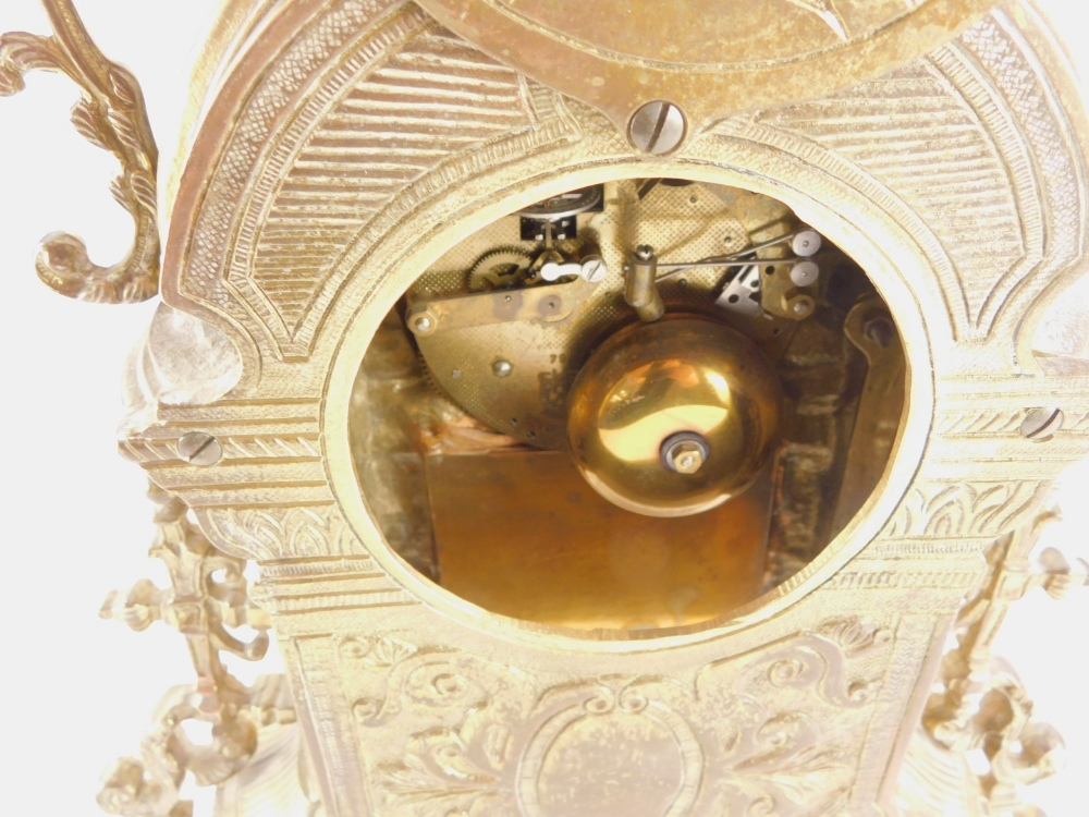 A Continental mantel clock, the rococo shaped cast brass case decorated with scrolls, the dial stamp - Image 3 of 3