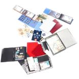 A quantity of stamps, mainly First Day covers, some coin trays, loose stamps, etc.