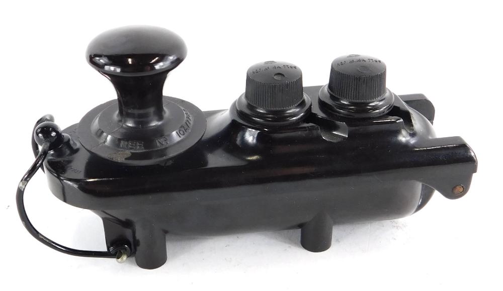 A Lancaster Bomber Bath shaped Bakelite Morse code key.