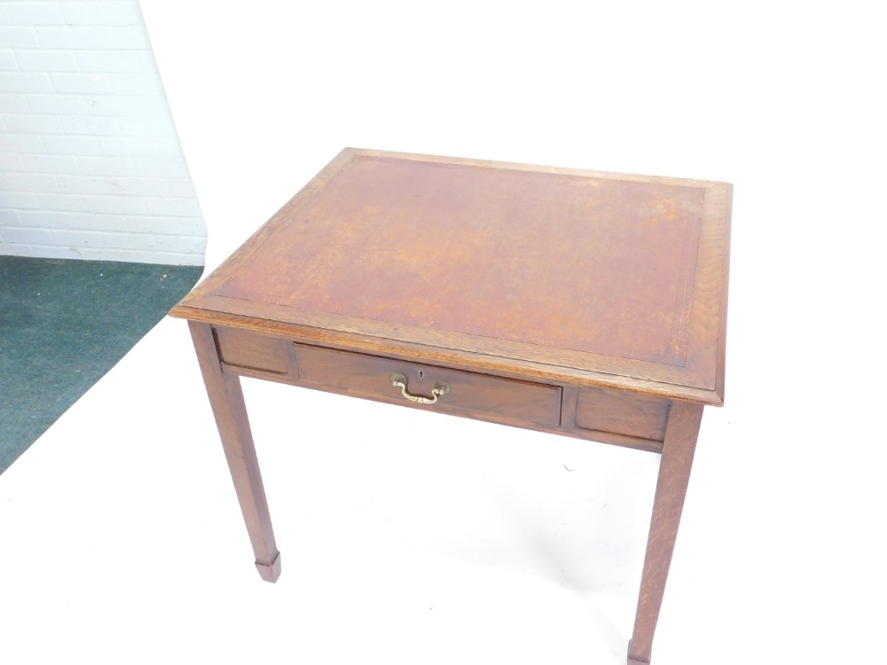 An oak and mahogany writing table, the top with a brown leather inset and moulded edge, above an ass - Image 2 of 2