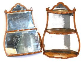 A pair of 19thC walnut and kingwood wall shelves, each with a mirrored back, shaped crest and shelve