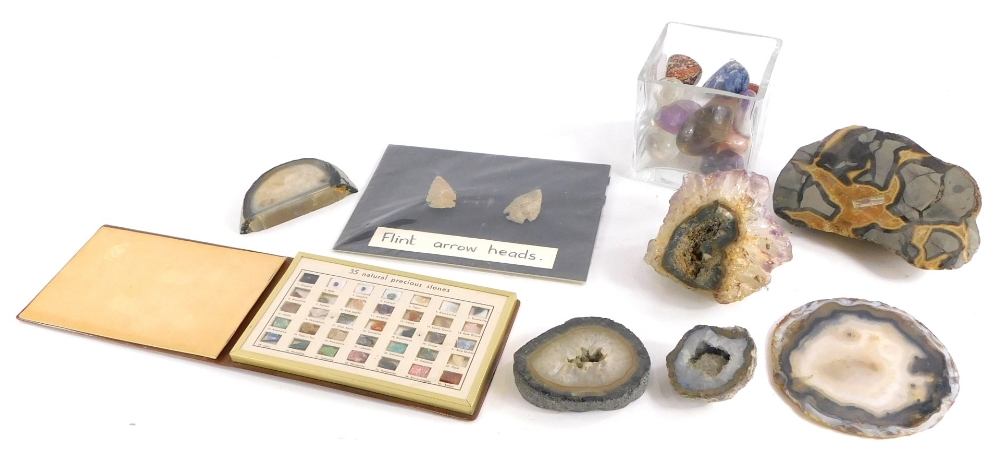 A collection of geodes, an amethyst crystal, polished stones, etc.