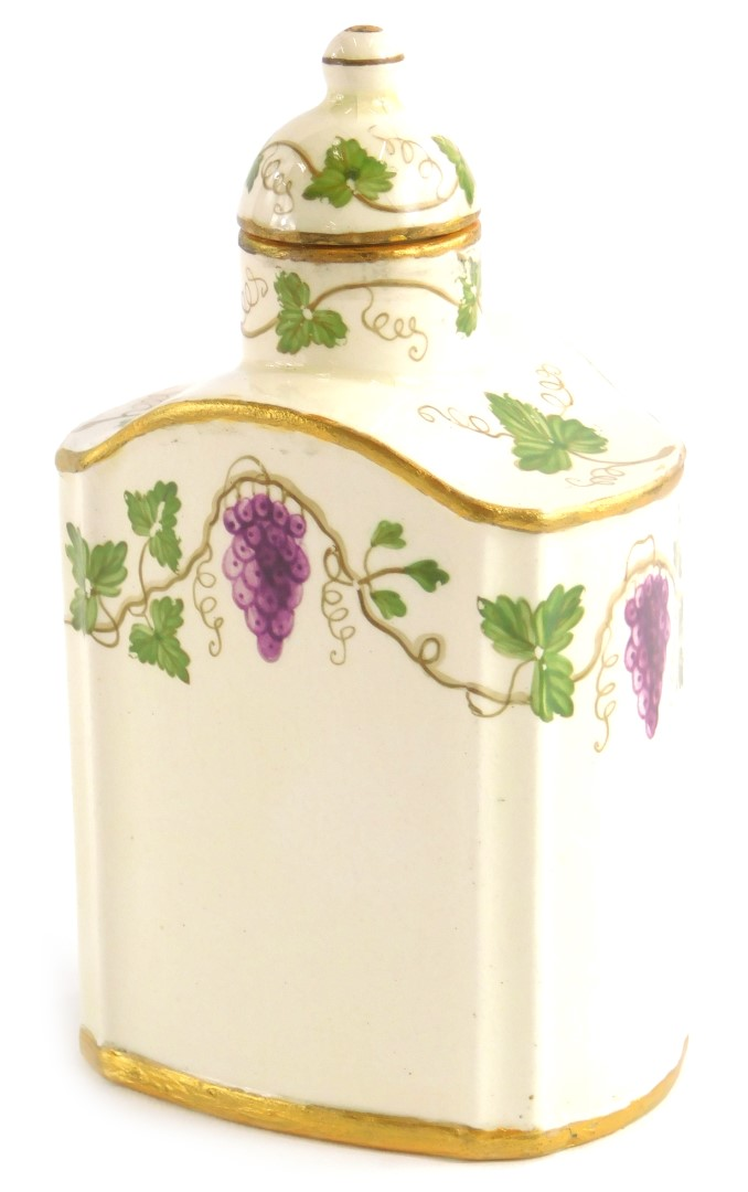 A late 19th/early 20thC Wedgwood ceramic tea caddy and lid, vented and painted with grapes and vines