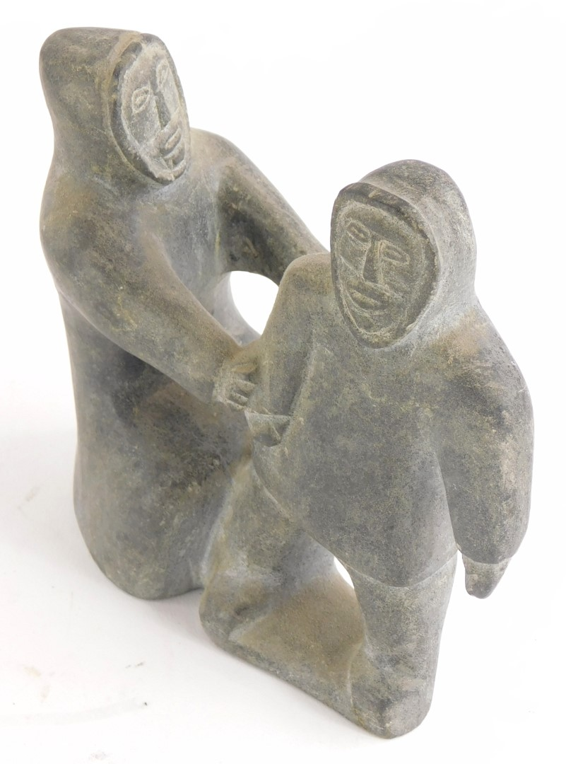 A Inuit stone carving of two Eskimos, label for Kinaaluk Ningicrlut, of Wakeham Bay, possible date 1