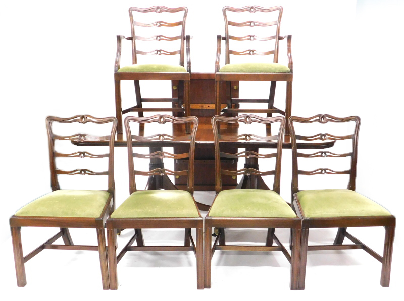 A set of six mahogany ladder back dining chairs in George III style, each with a green padded seat o